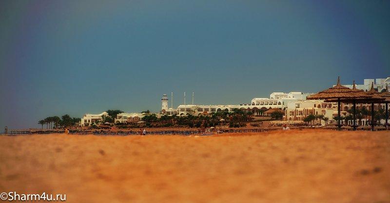 Дикий пляж в Шарм-эль-Шейхе (Монтаза) - вид в сторону отеля Барон и Сенсатори